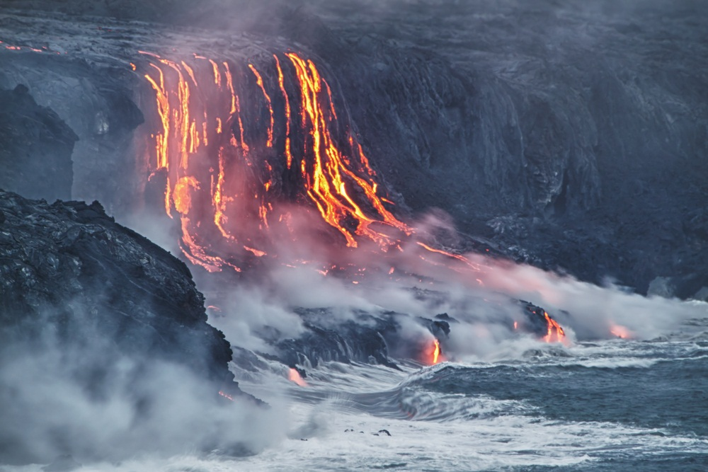 In recent years, the flowing lava from Kilauea volcano in Hawaii has destroyed 180 houses and 8 miles of highway—while adding 500 acres of rocky new shoreline to the island. (Alexey Kamenskiy/ Shutterstock)