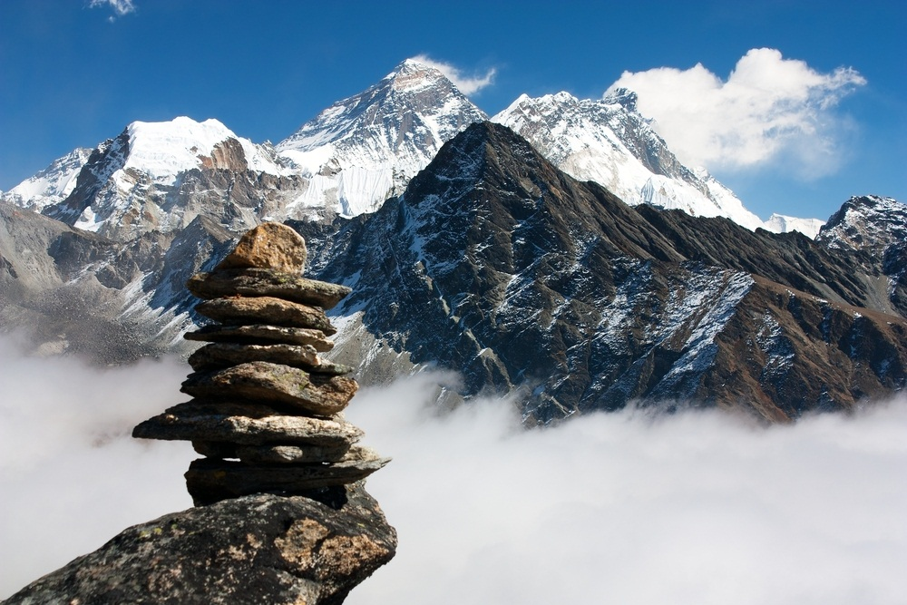 Mount Everest is the world's highest mountain. Astonishingly, the rock at its peak—29,000 feet up—was once on the bottom of an ancient ocean. The movement of Earth's plates pushed the old seabed onto the roof of the world. Pieces of 470-million-year-old shells have been found embedded in the rocky summit. Piles of flat stones are left as memorials to people who died while trying to climb Everest and other Himalayan peaks. (Dabiel Prudek/ Shutterstock)
