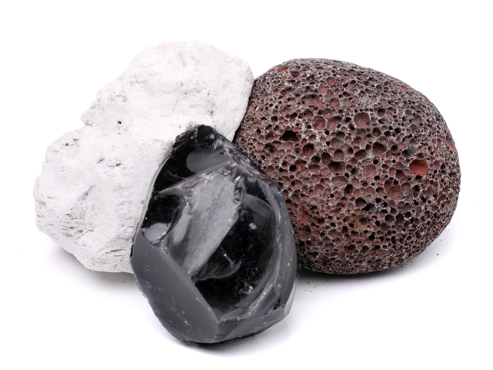 All three of these rocks are made of cooled-down lava. Obsidian is hard and smooth as glass, but the white and gray pumice stones are lightweight, rough, and porous. As fiery lava blasted out of a volcano, it hardened into pumice so quickly that it preserved the air pockets created by exploding gas bubbles. (Kletr/ Shutterstock)