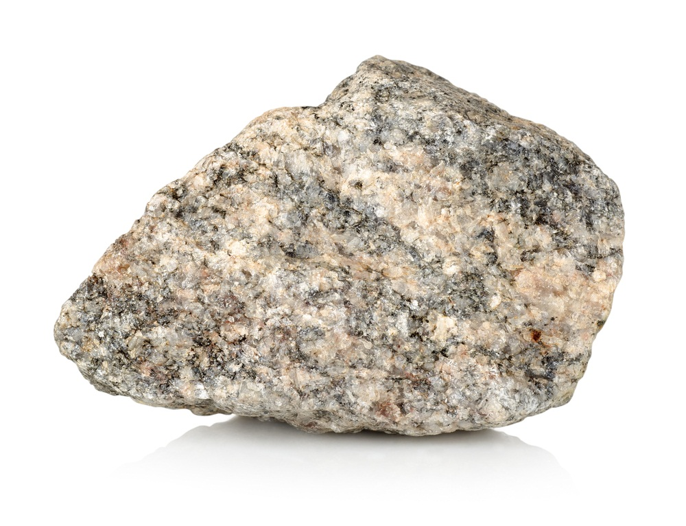 At least three types of mineral crystals are visible in this granite rock: the white, gray, and pink crystals are a mixture of quartz and feldspar, while the black is biotite. Granite is the primary basement bedrock of all the continents. (Givaga/ Shutterstock)