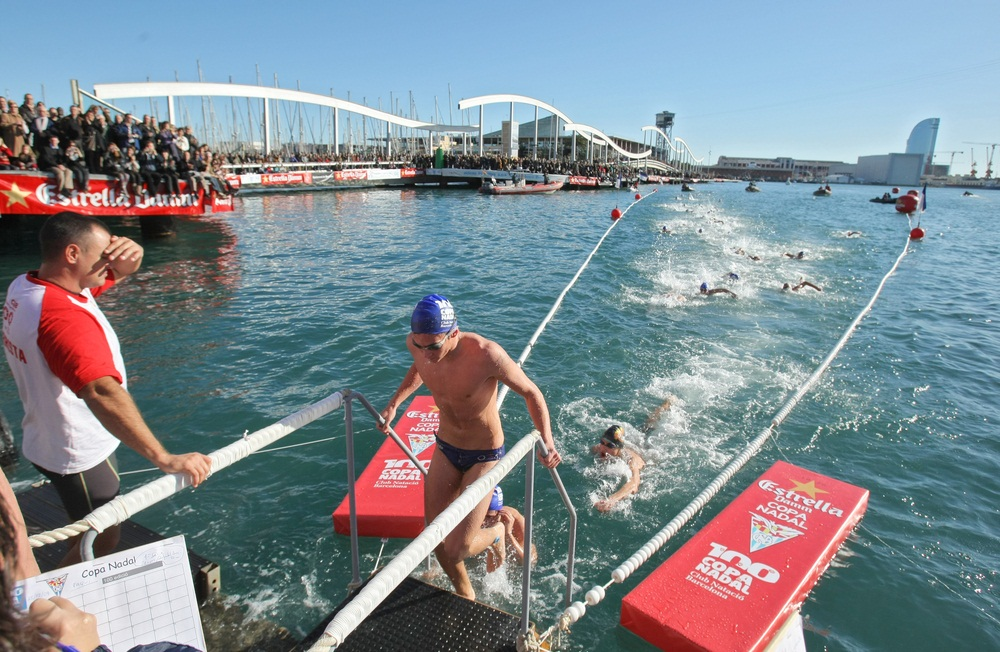 Swimmers in Barcelona, Spain, cross the city's Old Harbor during an open water swim. The distance is equivalent to four lengths of an Olympic-sized pool. (Maxisport/ Shutterstock)