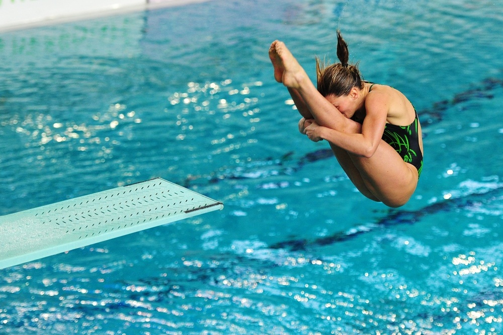 Olympic diver Francesca Dallape performs a somersaulting dive in the pike position. In the pike position, the legs are straight and the body is bent double at the waist. (Diego Barbieri/ Shutterstock)