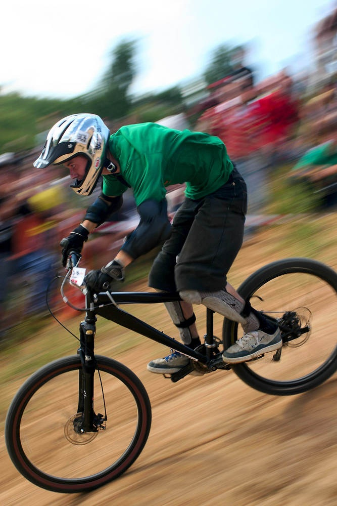 Downhill mountain bike racing can be blisteringly fast and jumps built into the courses send riders airborne. Wipeouts are common, so riders bulk up on protective gear. This downhill racer is wearing shin guards, knee pads, elbow pads, and a full-face helmet. (Andrey Khrolenok/ Shutterstock)
