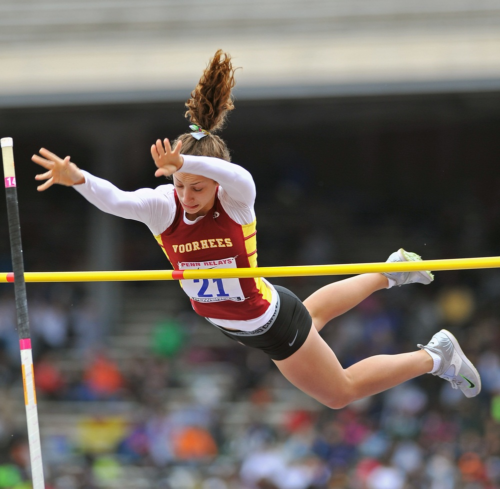 Pole vaulting is the highest flying of the track and field sports. Athletes choose the height of the bar and then get three chances to vault over without knocking it down. Technique and timing are everything. Competitors sprint down a track, plant the pole, and then swing up. At that point, the athlete is hanging on the pole upside down, but there's so much forward momentum that she can launch upward and flip her body over the bar (hopefully). A soft mat on the other side breaks her fall. The world record for pole vaulting is over 19 feet. (Aspen Photo/ Shutterstock)