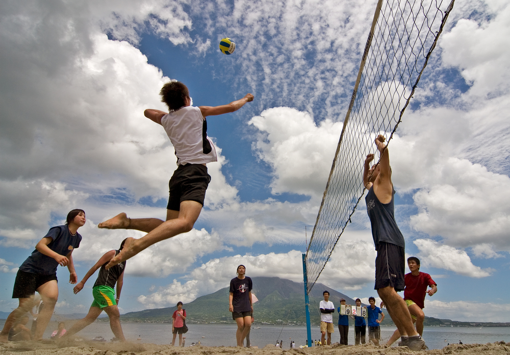 Do you like games near the water? Beach volleyball is played with just two people on each team. Players work closely to dig, set, block, and spike their way to victory. (wdeon/ Shutterstock)