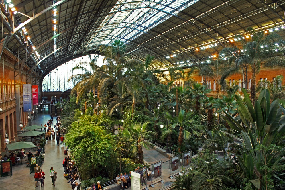 One year older than King's Cross, the Atocha Train Station in Madrid, Spain, is where subway lines and high-speed rail meet. This part of the station has been turned into a dining concourse with a tropical greenhouse. (dejan83/ Shutterstock)