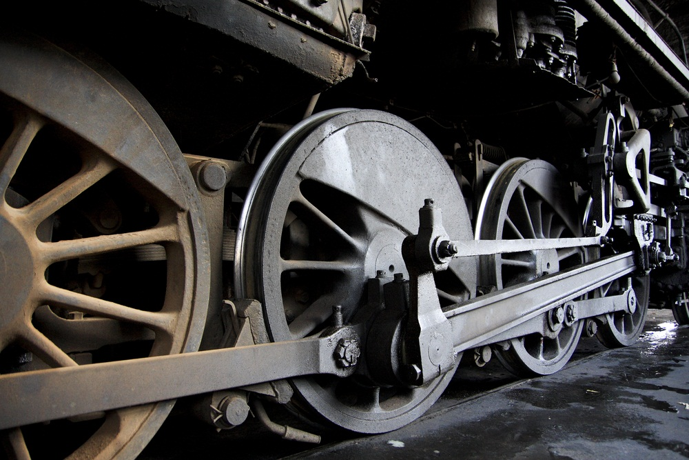 "A wide edge on the inside rim of each wheel (called a ""flange"") prevents the train from jumping off the tracks. The rods connecting the wheels are pushed back and forth by the engine. That turns the wheels and makes the train go. (Chen.Z/ Shutterstock)"