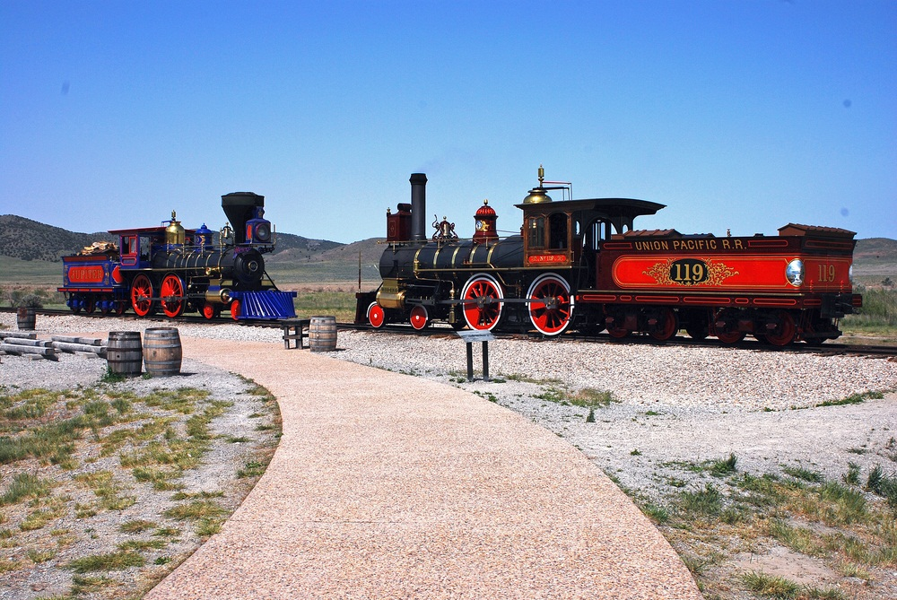 At Golden Spike National Park in Utah, two trains re-enact the completion of the transcontinental railroad. The two steam locomotives are working replicas of the Union Pacific #119 and Central Pacific Jupiter. (Jerry Susoeff/ Shutterstock)