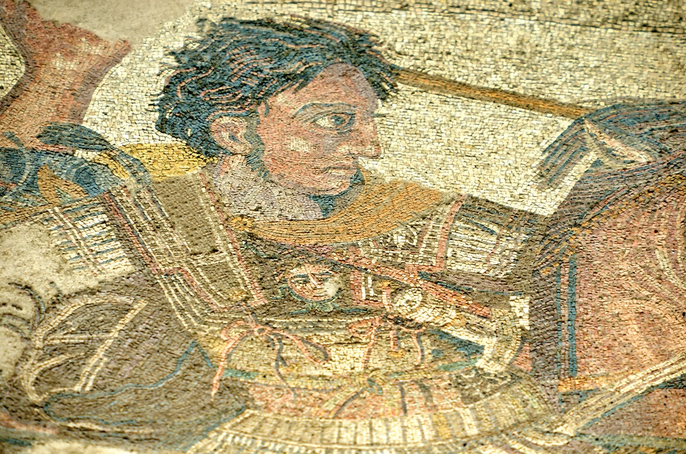 A section of an ancient mosaic found buried in the city of Pompeii shows Alexander the Great waging battle against Darius III, the Archaemenid emperor. On Alexander's armor, there is a medallion made of gold, picturing Medusa, the mythical Greek monster who had snakes for hair and could turn men to stone if they looked in her eyes.  (mountainpix/ Shutterstock)