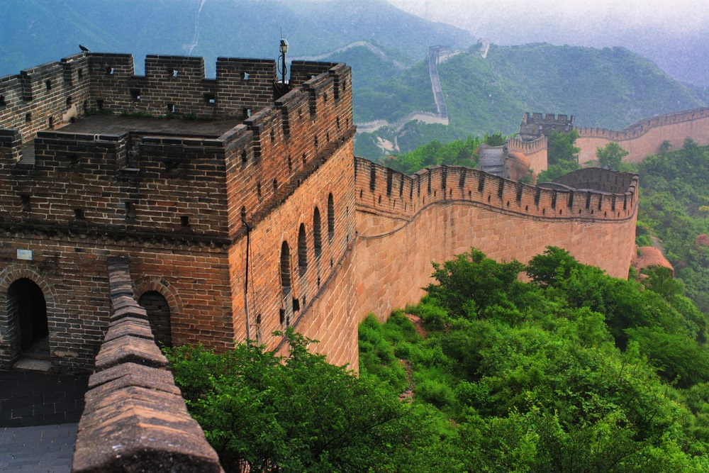 Emperor Qin Shi Huang initiated the construction of the Great Wall of China to protect against invasions from the north. Although Qin Shi Huang's wall is said to have stretched for 3,100 miles, very little of the original survives today. (Yuri Yavnik/ Shutterstock)