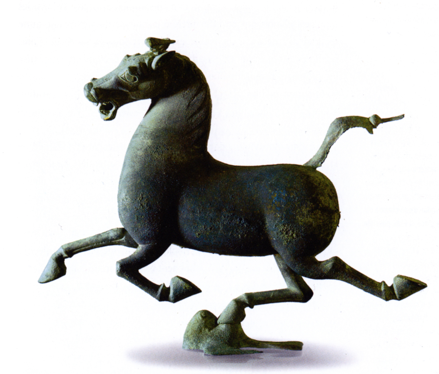 "The Flying Horse of Gansu is a bronze statue discovered in a Han Dynasty general's tomb at an important stop along the Silk Road. A ""heavenly steed,"" this flying horse is shown stepping on a surprised sparrow as they both streak across the sky. It is considered a masterpiece of ancient Chinese artwork. (Photo via Wikimedia Commons)"