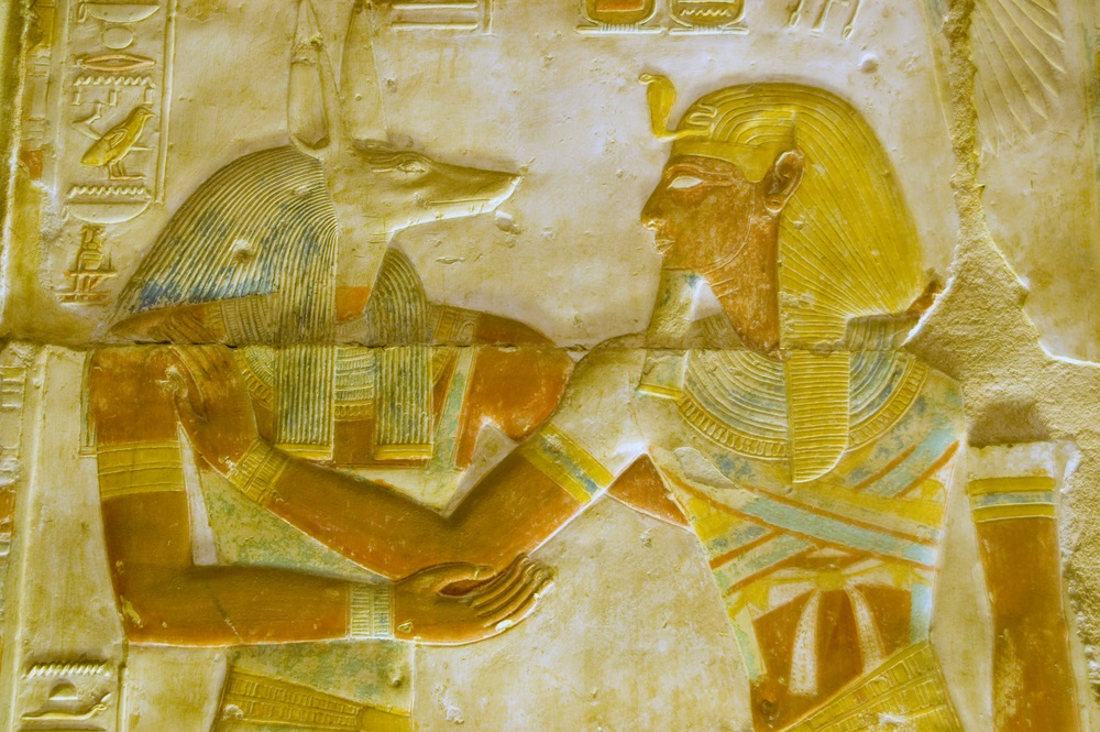 The pharaoh Seti, who died in 1279 BC, is shown being welcomed by Anubis, the jackal-headed god and protector of the dead. This carving is found at the Temple of Abydos, which is dedicated to Seti. (BasPhoto/ Shutterstock)