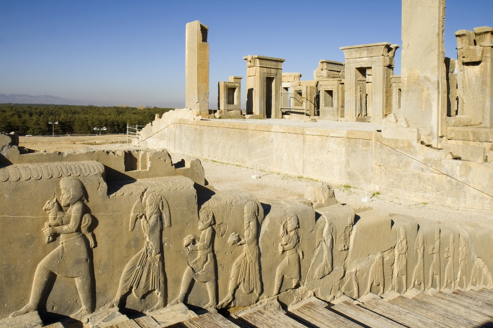 Persepolis was the center of the Archaemenid Empire, with palaces dedicated to its rulers Darius the Great and Xerxes. Now in ruins, this stairway shows the people of the empire walking into the palace, bringing gifts. (arazu/ Shutterstock)