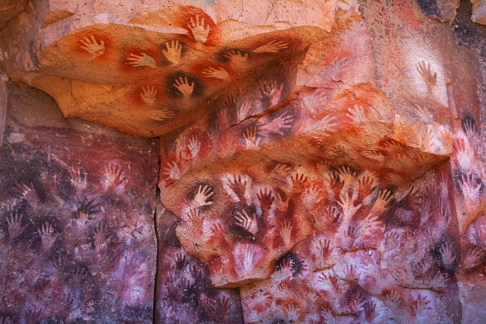 Today, people display art in special places—like museums. Ancient people put their art is special places, too. Scientists have discovered that some cave paintings were done in locations where there are strong echoes. They even found that in places where there are ancient paintings of horses that the echoes sound like hoof beats! These hand stencils in Patagonia, Argentina, are about 10,000 years old. What do you think it would sound like if you clapped your hands nearby? (sunsinger/ Shutterstock)