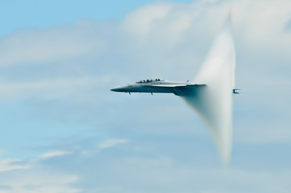"When an object moves at the speed of sound, it is said to be traveling at Mach 1. When a jet surpasses the speed of sound, it ""breaks the sound barrier"" and causes a sonic boom—which sounds like a clap of thunder. When it's humid, jets form a vapor cone as they break the sound barrier.  (Katerina_S/ Shutterstock)"