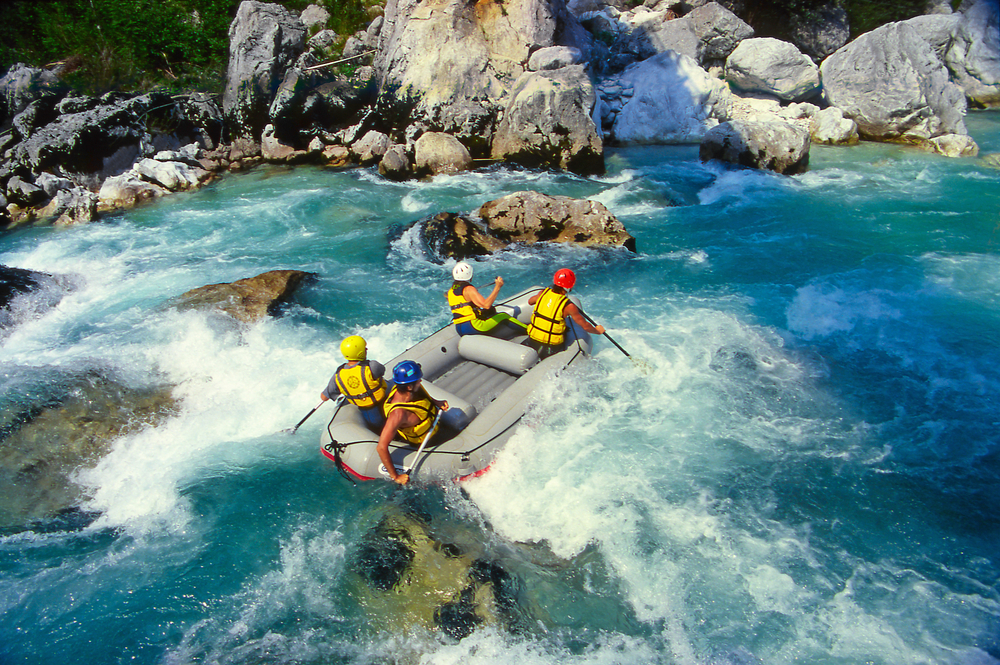 """Rapids"" form when a river channel gets shallower, narrower, or steeper—or all three. The water flows faster and is choppy and unpredictable. Running rapids in a boat can be both thrilling and dangerous. (Pecold / Shutterstock)"