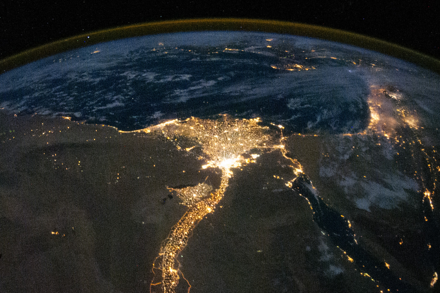 "Even today, Egypt's population is concentrated along the banks of the Nile and in the Nile delta. This nighttime photo (taken by an astronaut on the International Space Station) shows the lights of homes along the ""stem"" of the Nile and fanning out in the delta where the river reaches the Mediterranean Sea. (NASA)"