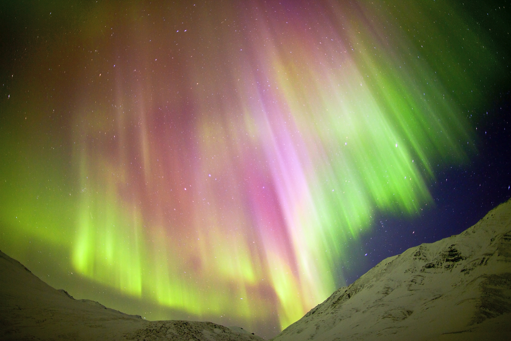 "Auroras with this crown shape are referred to as ""coronas."" (Dhanachote Vongprasert / Shutterstock)"