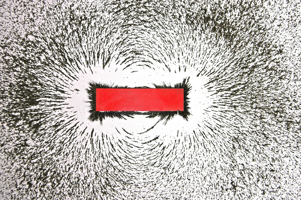 The magnetic field that surrounds Earth is similar to the magnetic field of this bar magnet. (Awe Inspiring Images / Shutterstock)