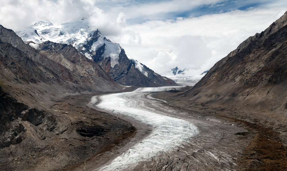 Glaciers such as this one in India shape much Himalayan scenery. The glaciers carve valleys, pile up crumbly ridges called moraines, and create meltwater lakes. (Daniel Prudek / Shutterstock)