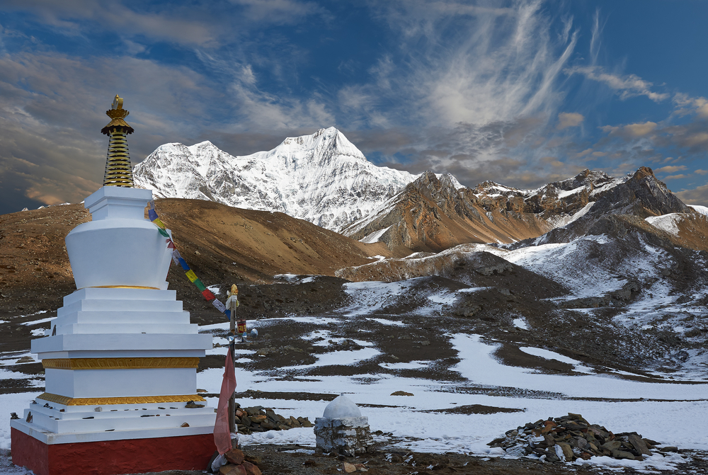 Monuments called stupas are common along roads and trails. This stupa is along a popular trekking route near the 26,545-foot-high peak of Annapurna in Nepal. (Yuri Taranik / Shutterstock)