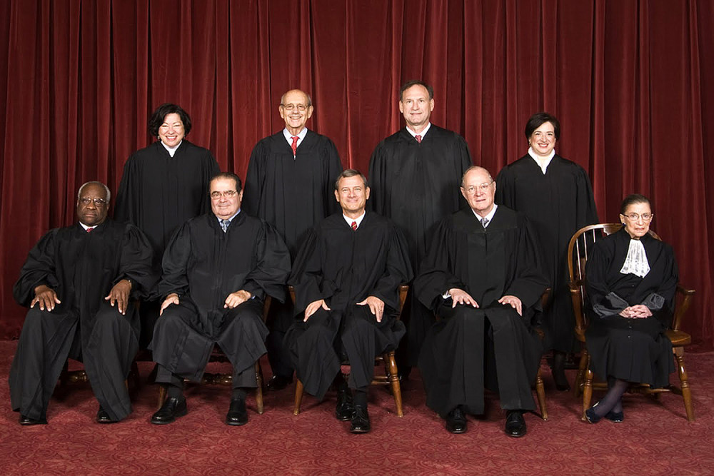 "Meet the Supremes! From top left to right, Sonia Sotomayor, Stephen Breyer, Samuel Alito, and Elena Kagan. From bottom left to right, Clarence Thomas, Antonin Scalia, John Roberts, Anthony Kennedy, and Ruth Bader Ginsburg. John Roberts is the chief justice, and Elena Kagan is the ""junior justice,"" which means she is the justice most recently appointed to the court. (Photo Credit: Steve Petteway)"
