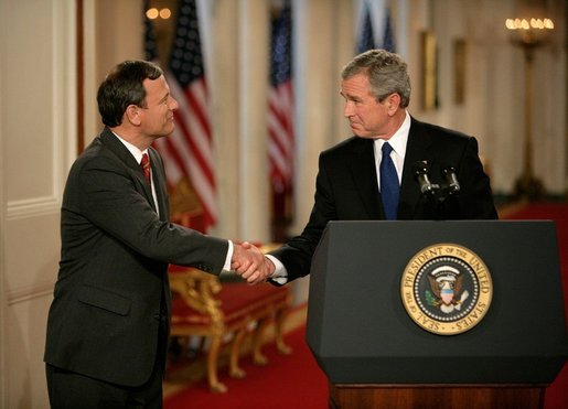 Bush congratulates John Roberts after nominating him to the Supreme Court. (Photo Credit: Public Domain)