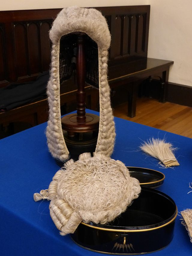 "White powdered wigs (made of horsehair) were worn by judges and lawyers in British courts. But the U.S. Supreme Court did not adopt this style. In fact, Thomas Jefferson advised—not long after he wrote the Declaration of Independence—""for heaven's sake, discard the monstrous wig."" (Photo Credit: Kim Traynor)"