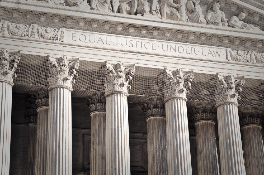 "The Supreme Court Building in Washington, D.C., was built in 1935 in the style of an ancient Roman temple. The columns hold up the court's motto, ""Equal Justice Under the Law."" (Shutterstock: Brandon Bourdages)"