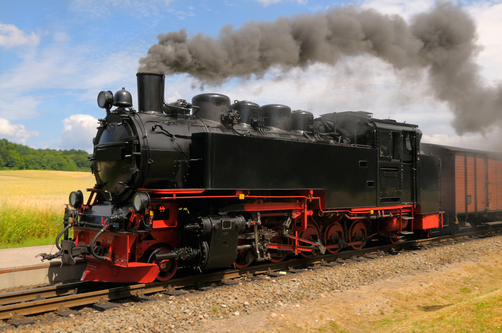The steam locomotive in front pulls all the train cars. The engine needs fuel and LOTS of water to create steam power. (Shutterstock / Anya Ivanova)