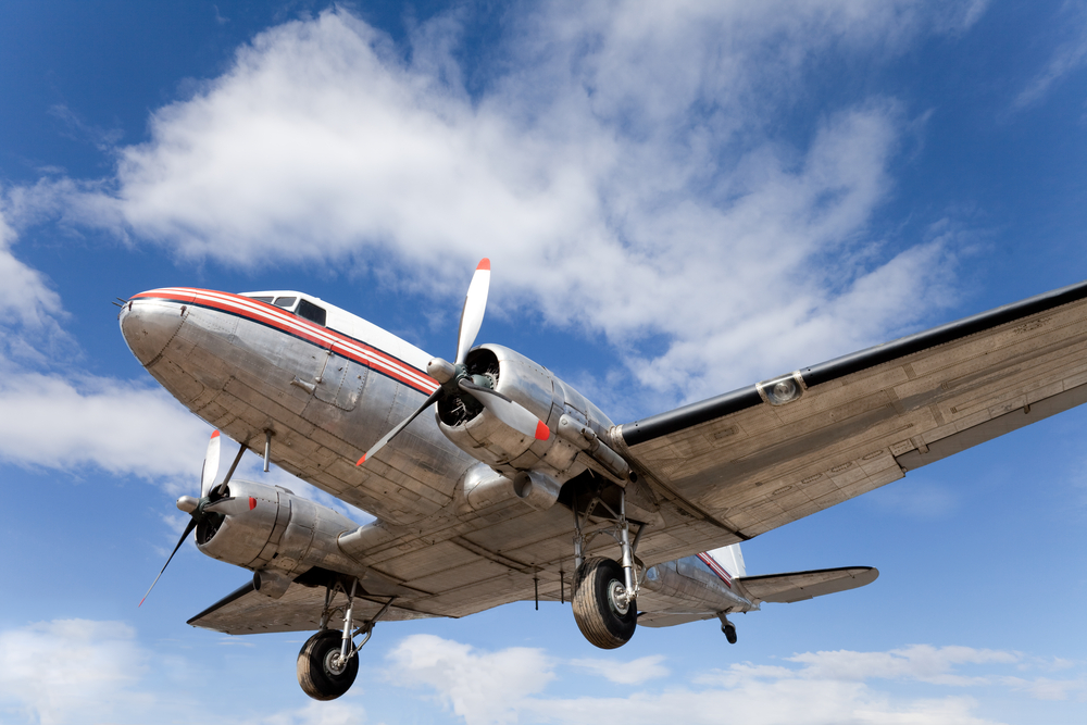 First produced in 1936, the DC-3 was the plane that made air travel popular with the public. On previous models, the sound of the internal combustion engine had been almost unbearably loud. Soundproofing made flying on the DC-3 much more comfortable. (Shutterstock / Pi-Lens)