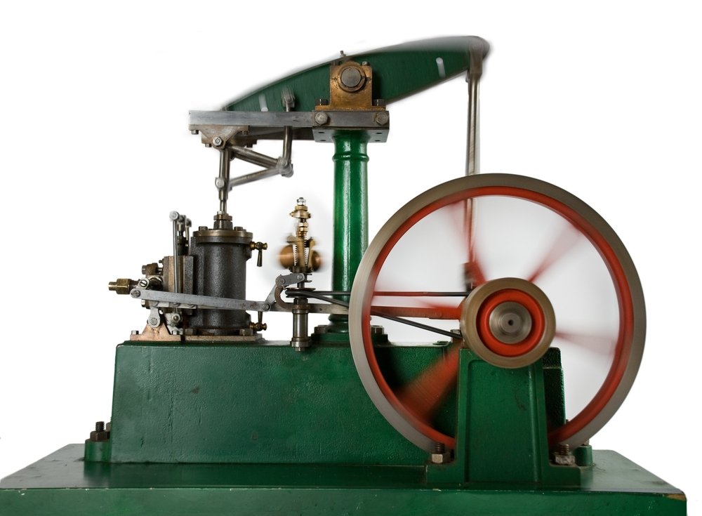 Like the Newcomen steam engine, the Watt rotative engine had a teeter-totter beam. In Watt's engine, the beam connects to gears that drive a wheel. (Shutterstock / Baptist)