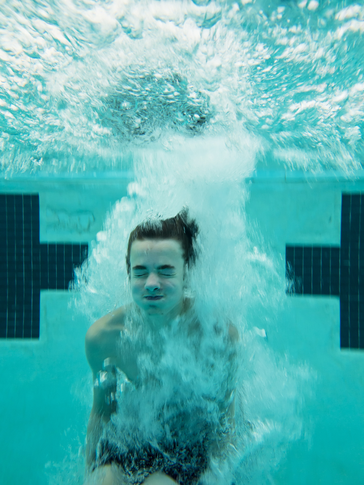 When you cannonball into a pool, you create a huge splash. The force of your body hitting the water is what puts the water in motion. (Shutterstock / John Wollwerth)