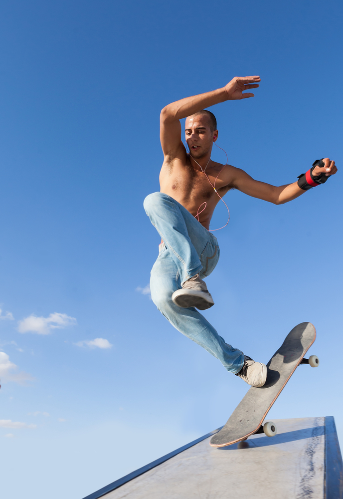 Inertia in action: The front wheel of this skateboard hits an obstacle and stops suddenly, but the rider keeps moving. (Shutterstock / Oleksandr Lysenko)