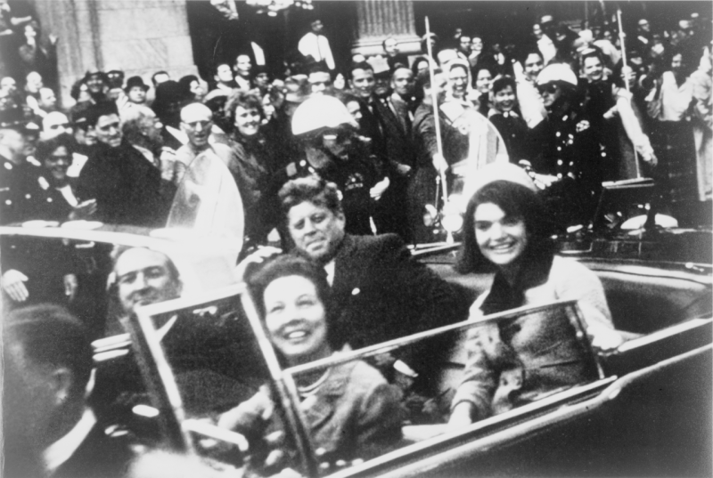 JFK and Jackie Kennedy ride in the presidential motorcade through the streets of Dallas on the day of JFK's assassination. Governor Connally, who was riding in the front seat with his wife Nellie,was also seriously wounded, but he survived his injuries. (Victor Hugo King / Library of Congress)