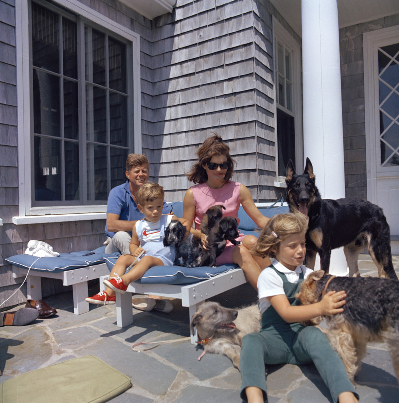 JFK and Jackie Kennedy relax in Hyannis Port in Massachusetts with Caroline and John Jr., and their many dogs. (Cecil Stoughton / John F. Kennedy Presidential Library and Museum)