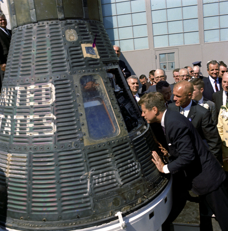 """JFK looks inside the """"Friendship 7"""" space capsule that carried astronaut John Glenn into space a few days earlier, making him the first American astronaut to orbit the Earth. (Cecil Stoughton / John F. Kennedy Presidential Library and Museum)"""