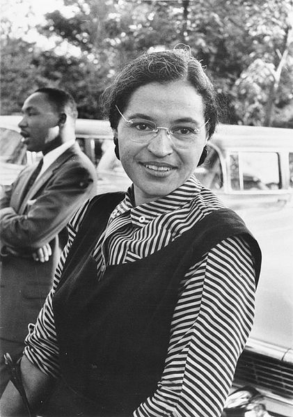 Rosa Parks launched the first major protest of the Civil Rights Movement. Martin Luther King, Jr., (seen in the background) became one of the most important leaders of the movement she inspired. (USIA / National Archives)