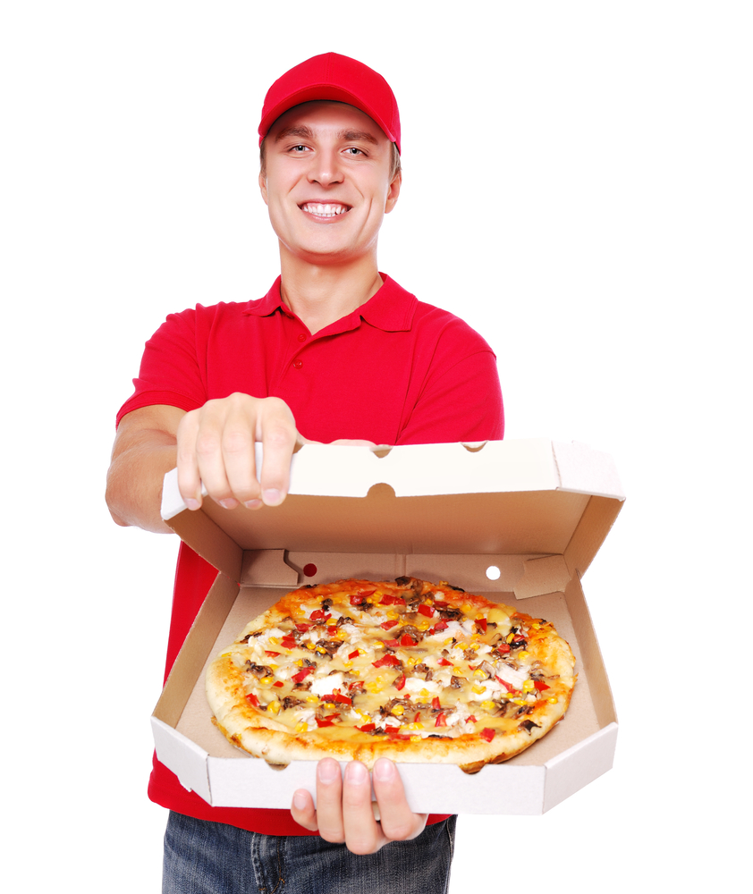 """Pizza companies sell a combination of goods and services. The pizza is a """"good."""" Delivering the pizza to your door is a """"service."""" (Kalmatsuy / Shutterstock)"""
